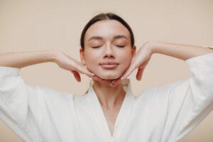 young,woman,doing,face,building,yoga,facial,gymnastics,self,massage