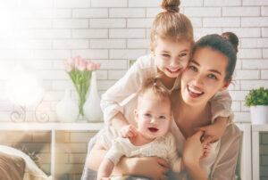 happy,loving,family.,mother,and,her,daughters,children,girls,playing