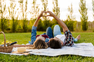 happy,couple,in,love,,lying,on,the,park,and,enjoying