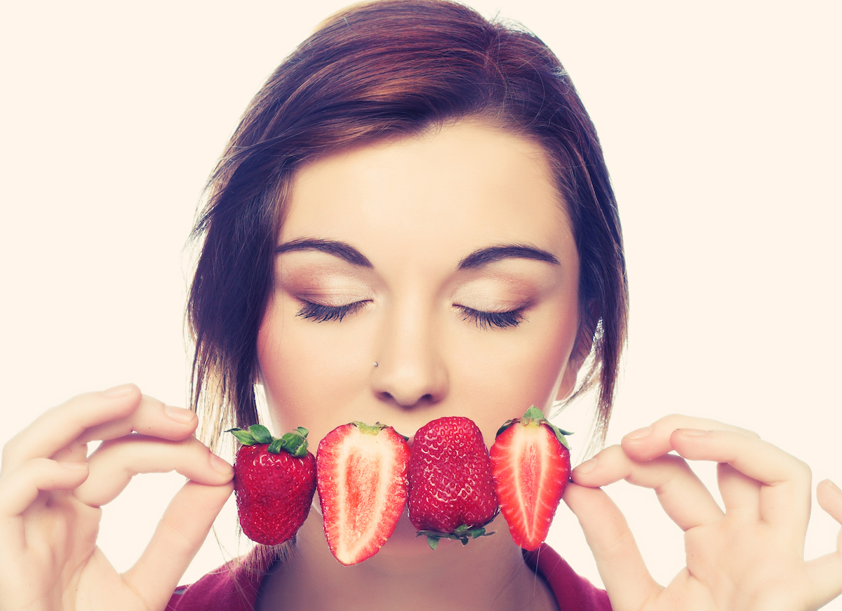 young,happy,girl,with,fresh,strawberries