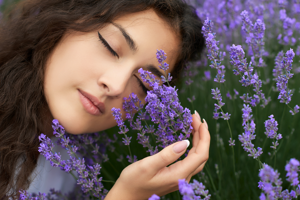 beautiful,young,woman,portrait,on,lavender,flowers,background,,face,closeup