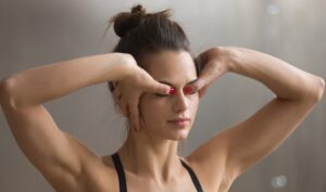 Young Woman Practicing Kriya Technique For Eyes And Stress Relie