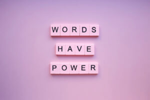 words,have,power,,on,a,pink,background