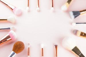 makeup,brushes,on,pink,background.,set,of,golden,makeup,brushes,
