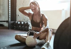 young fit woman exercise with kettle ball getting tired picture id1165279566 copy